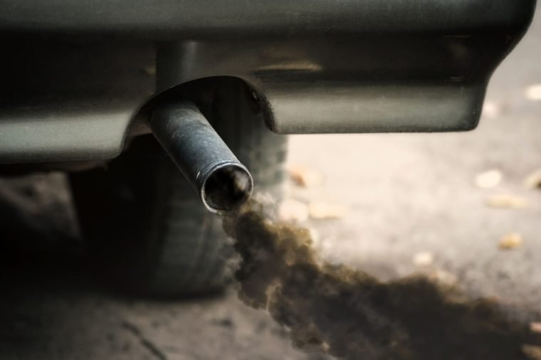 Smoke from old dirty car pipe exhaust.