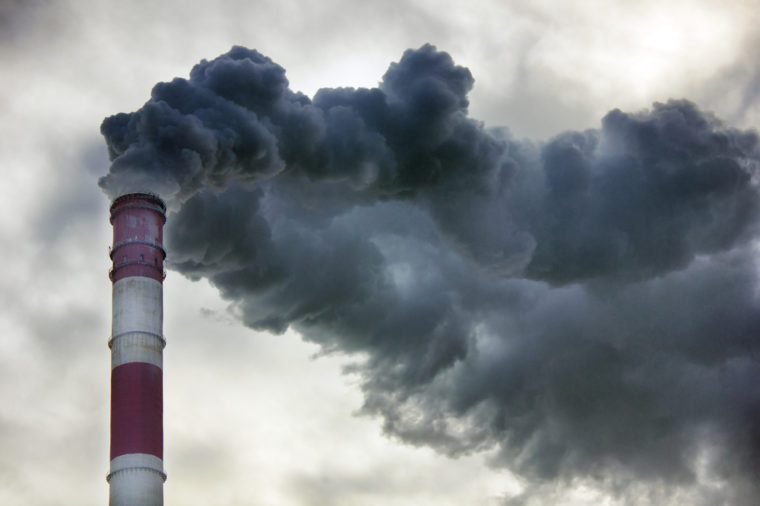 Air pollution, closeup of one big smoking pipe