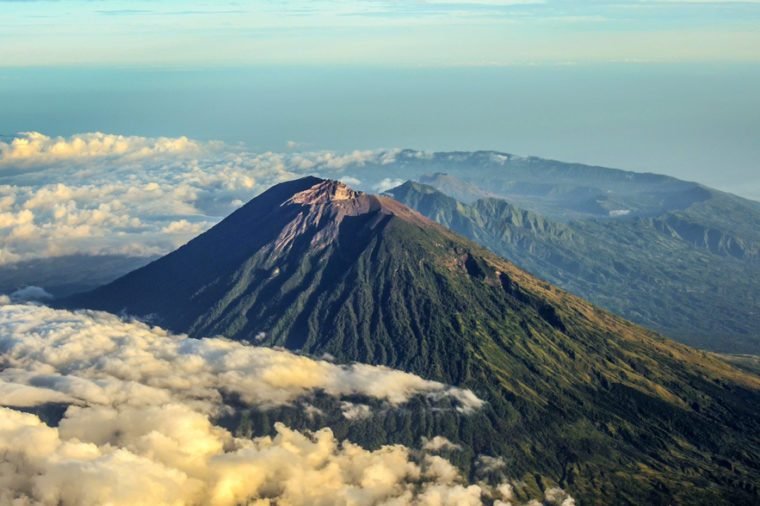 Mount Agung Bali early in the morning as seen from air plane window.