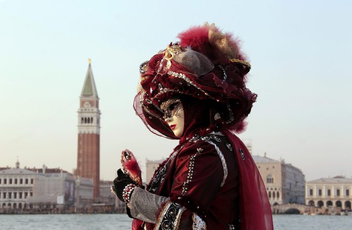 VARIOUS Woman wearing a mask, Carnival in Venice, San Giorgio Maggiore, Venice, Veneto, Italy