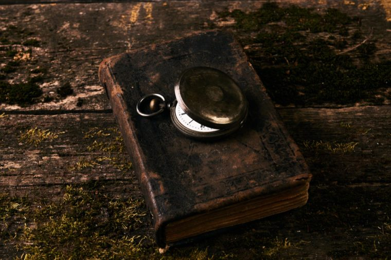 Old vintage pocket watch with old antique bible book