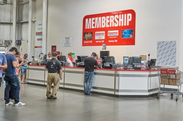 TORONTO, CANADA - AUGUST 15, 2018: Line of a people at customer service desk in a Costco store. Costco, is an American corporation which operates a chain of membership-only warehouse clubs.