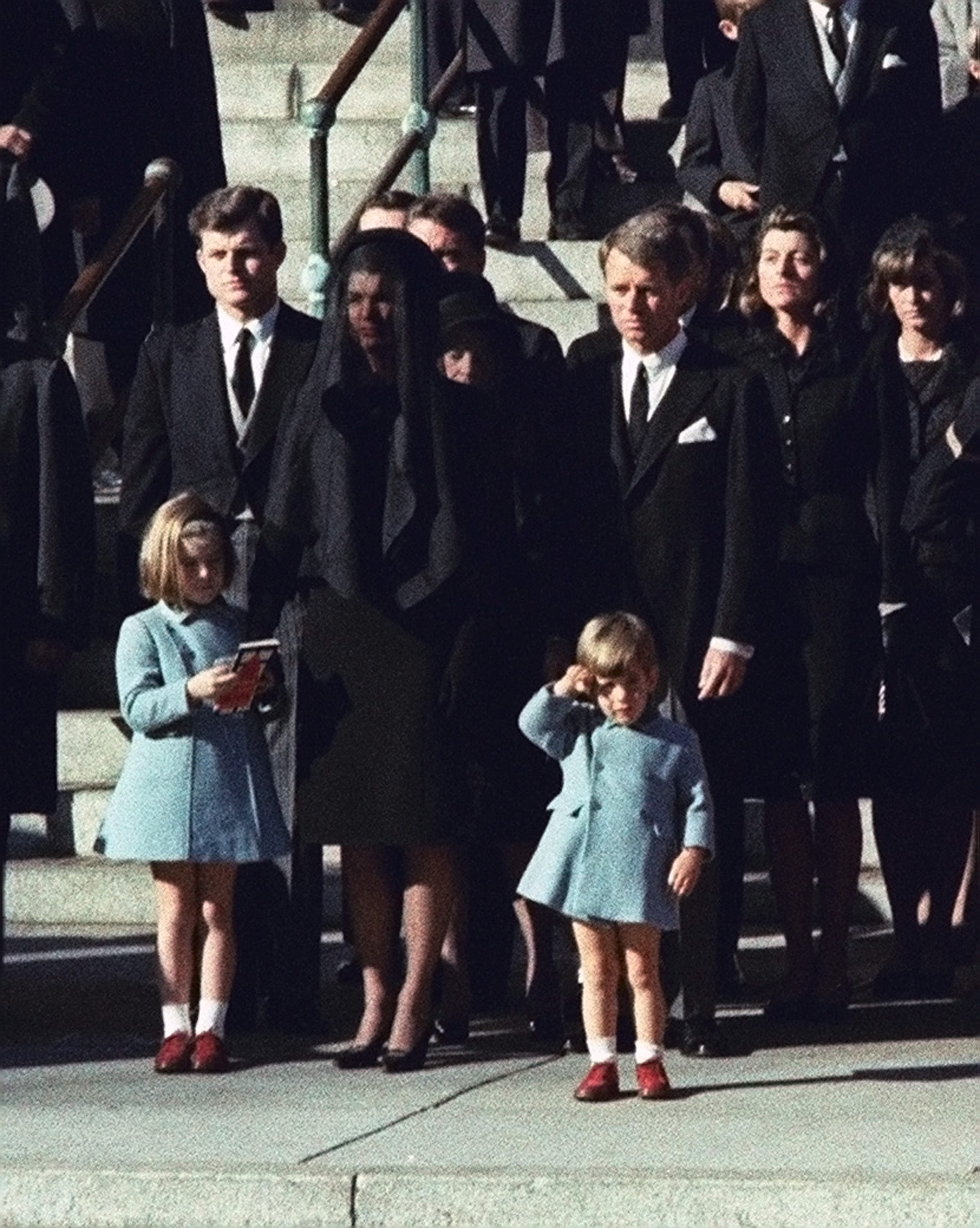 Three-year-old John F. Kennedy Jr. saluting his father's casket