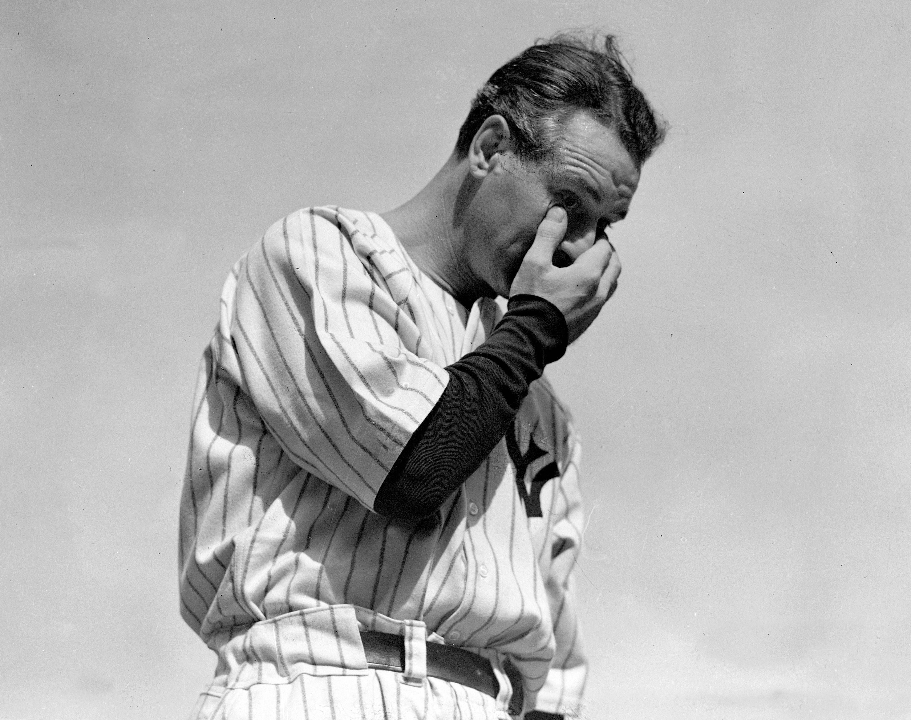 Lou Gehrig wipes away a tear while speaking during a tribute at Yankee Stadium in New York.