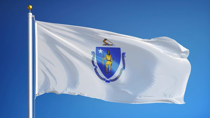 Massachusetts (U.S. state) flag waving against clear blue sky, close up, isolated with clipping path mask alpha channel transparency, perfect for film, news, composition
