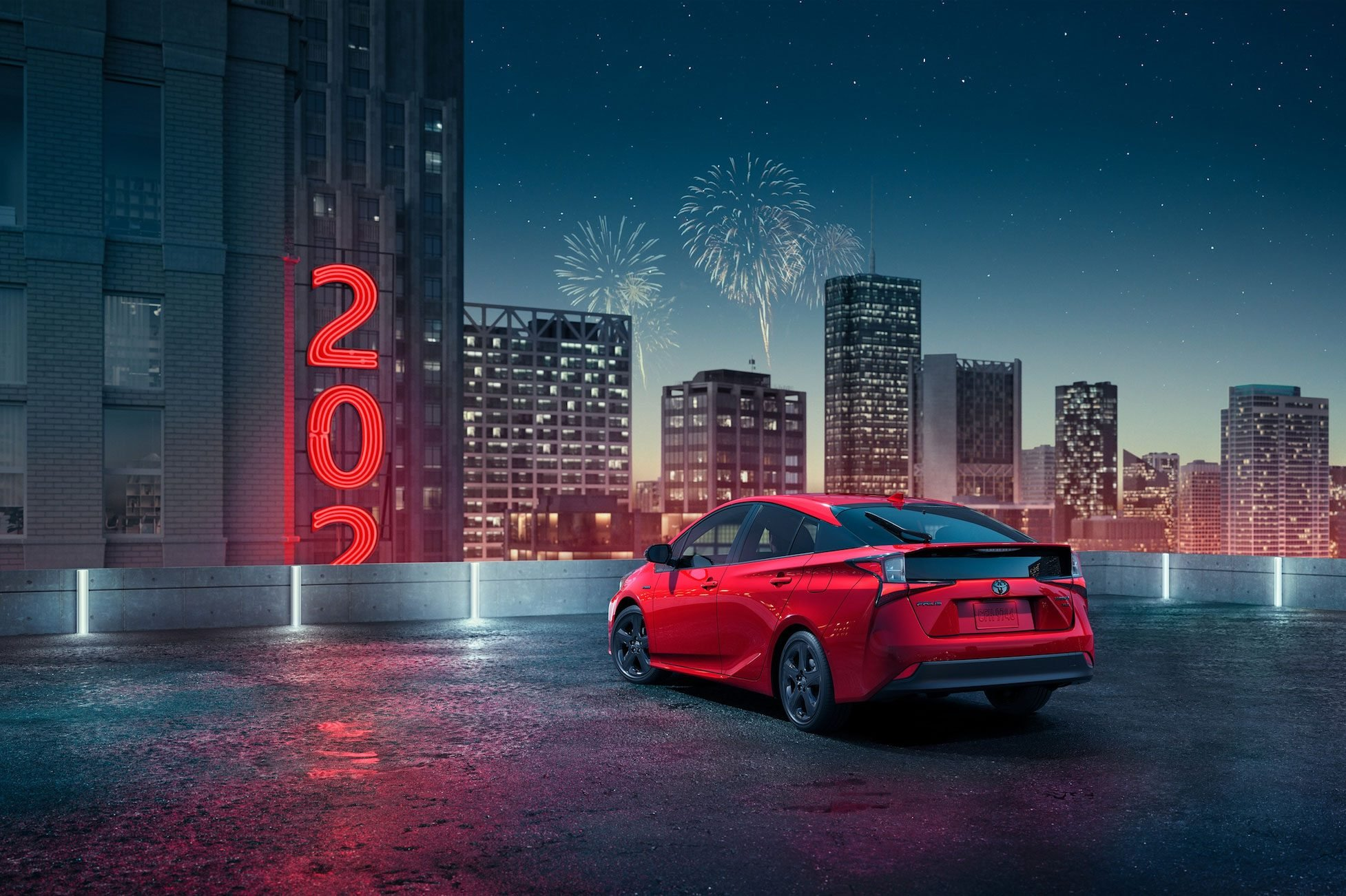 2021 toyota prius on a rooftop ringing in the new year with fireworks