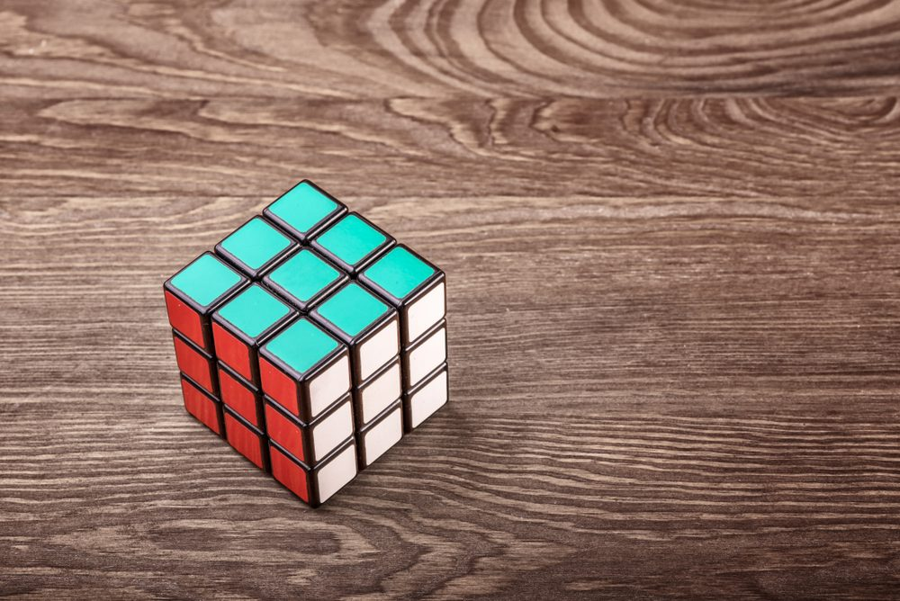 puzzle cube on a wooden table