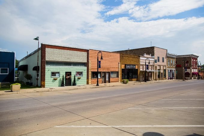 When farmers struggle, towns feel the pinch too. Downtown Onaga, Kansas, is studded with boarded-up storefronts.