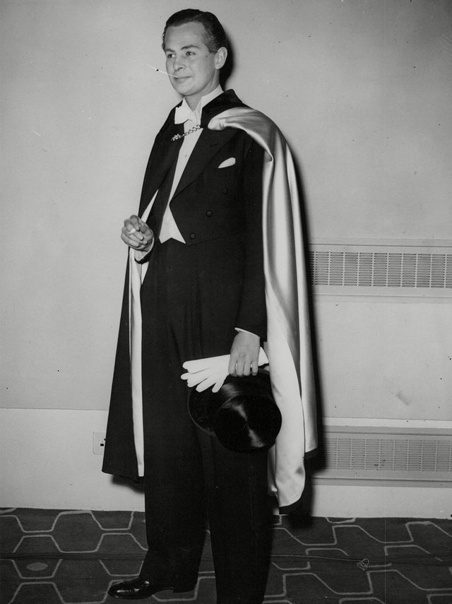 Actor Derek Bond Wearing An Opera Cloak And Full Evening Dress At A Men's Fashion Show At The Royal Festival Hall. Box 720 305121625 A.jpg.