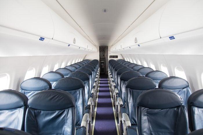 Dark Blue Seats in a Empty Jet Airplane