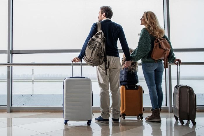 airport couple suitcases travel