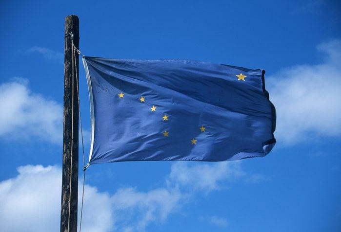 State Flag of Alaska against the sky
