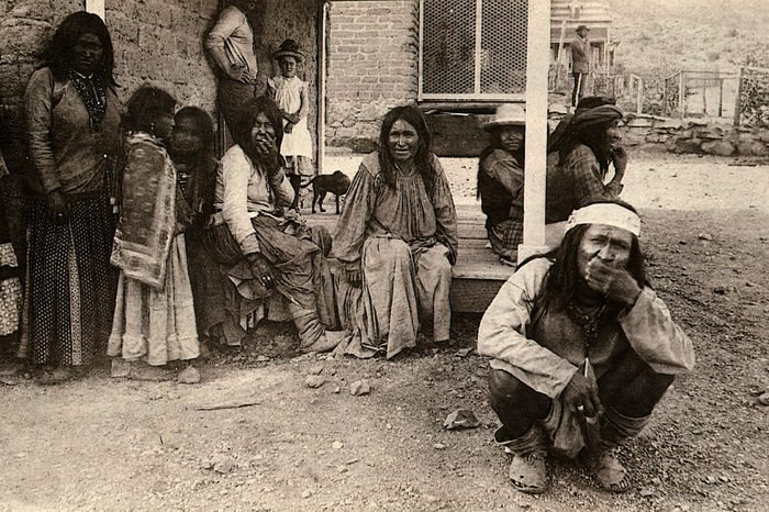"""Art (History) - various GERONIMO (Goyathlay, """"One who Yawns""""), 1829-1909 Apache Indian Chief (crouching, foreground) and Chiricahua Indians at Fort Bowie, Arizona, USA,1880s, after their surrender to U.S. army, showing worn-out moccasins (because of being kept on the move by troops, they had no time to kill stock and make new shoes)"""