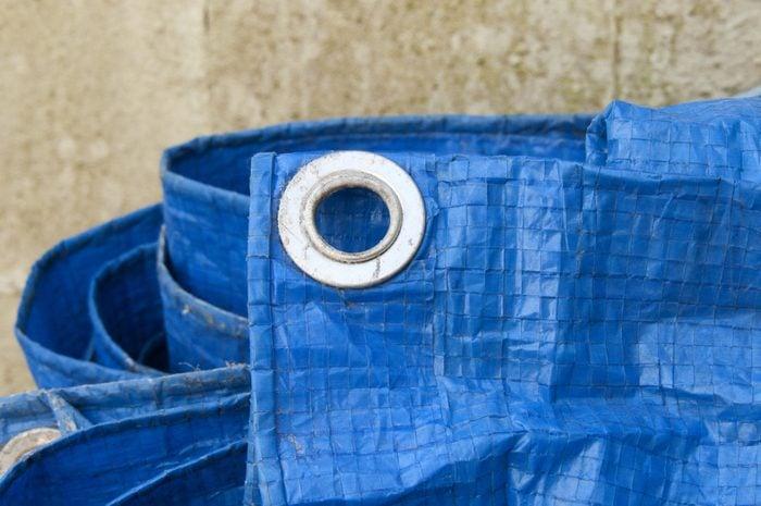 blue tarpaulin with eyelet