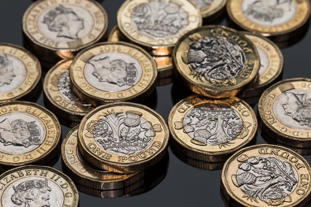 New British Pound Coins (on black)