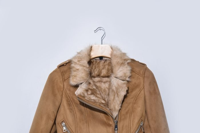 Warm winter jacket isolated on a white background. Women clothes coat Of artificial leather and fur