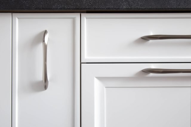 Kitchen cabinets with classic traditional fronts, close-up.