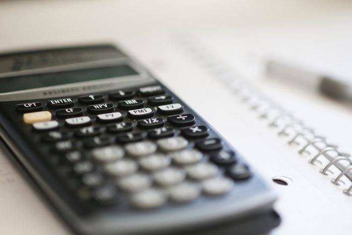 Homework background. Super close up of a calculator on a notebook.