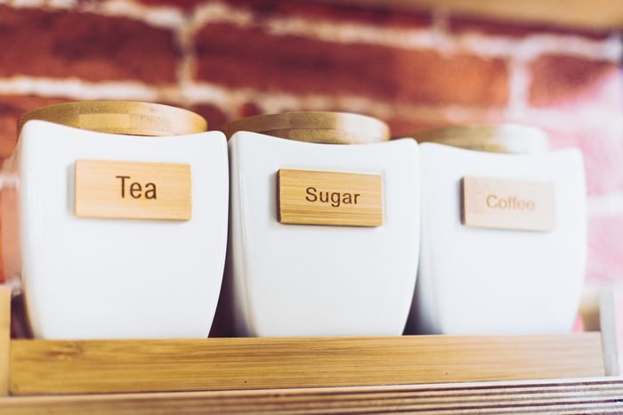 Modern white tea sugar coffee canisters set of three. Ceramic containers.