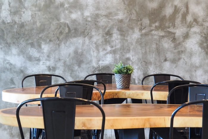 available metal chair and wooden table in restaurant, canteen or cafe