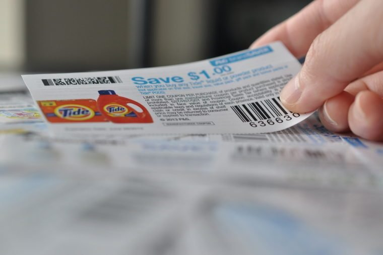 COQUITLAM, BC, CANADA - MAY 8 - Coquitlam BC Canada - May 8, 2014 : Holding coupon for saving item. All coupons for Canadian store, they are issued by manufacturers of consumer packaged goods Canada.