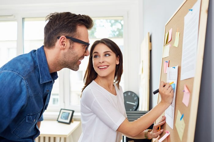 Creative couple working at office planning new business ideas