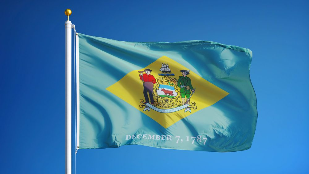 Delaware (U.S. state) flag waving against clear blue sky, close up, isolated with clipping path mask alpha channel transparency, perfect for film, news, composition