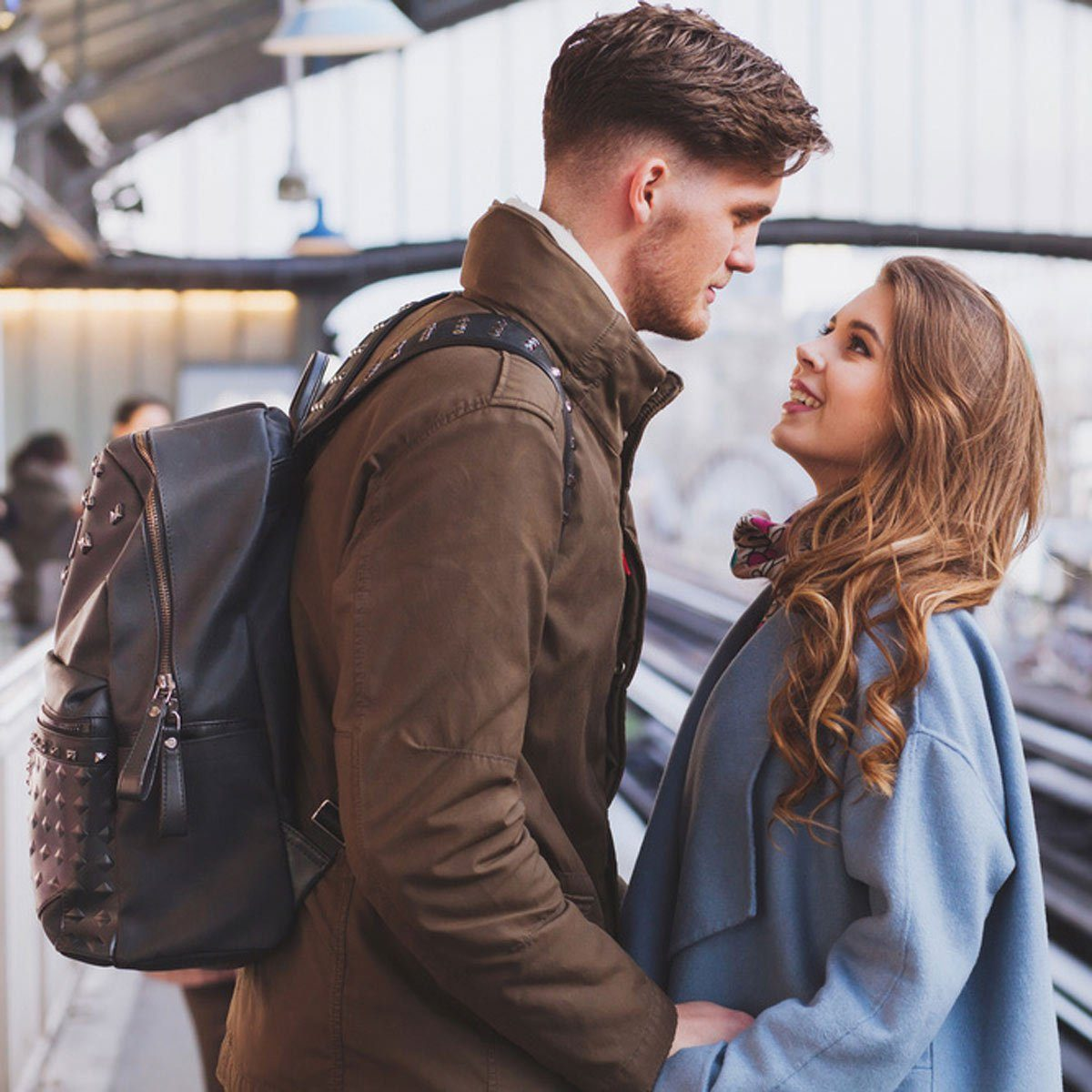 young couple looking at each other travel
