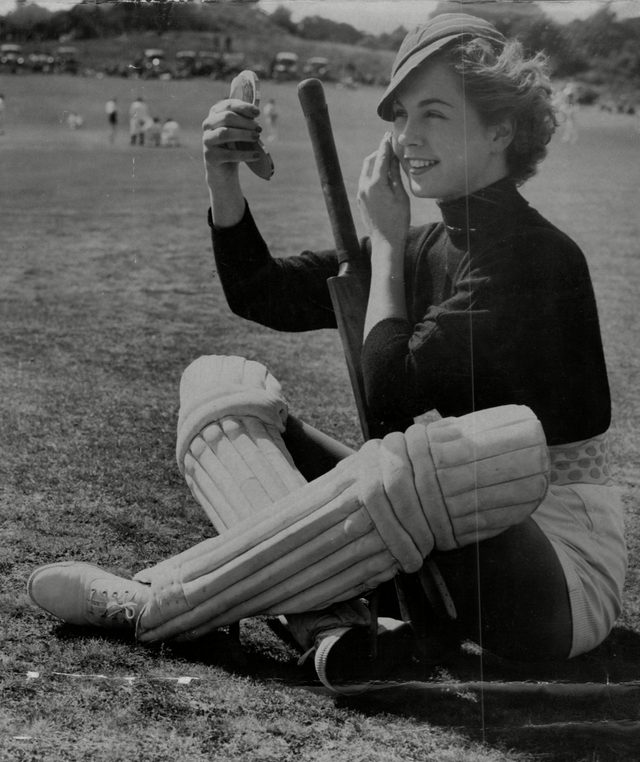 Diana Ferry Of The Lucy Clayton Cricket Team Adjusting Her Make Up During A Cricket Match Against A Men's Team In The Village Of Puttenham.