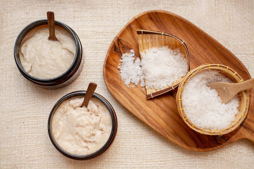 Spa Set. Handmade Salt Scrub And Cream Scrub With Coconut Oil. Scrub in bathroom. Thailand.