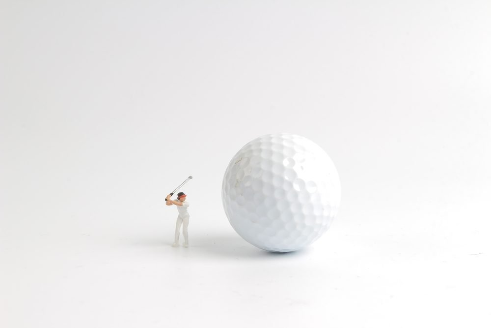 the mini figure play golf on big golf