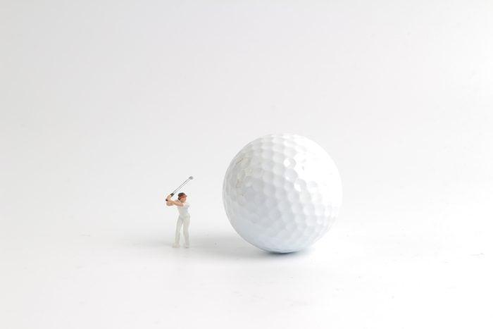 the mini figure play golf on big golf
