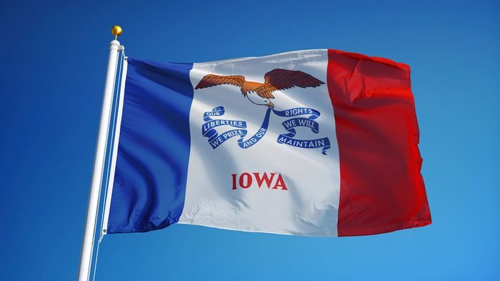 Iowa (U.S. state) flag waving against clear blue sky, close up, isolated with clipping path mask alpha channel transparency, perfect for film, news, composition