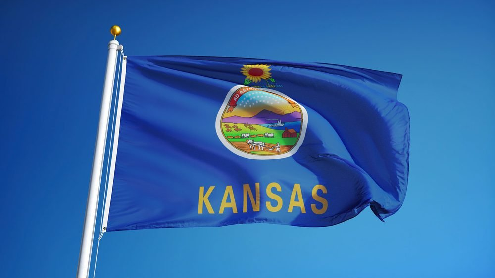 Kansas (U.S. state) flag waving against clear blue sky, close up, isolated with clipping path mask alpha channel transparency, perfect for film, news, composition