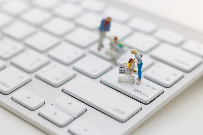 laptop keyboard miniature people shopping online