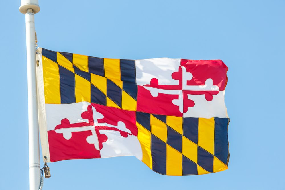 The flag of the state of Maryland against blue sky
