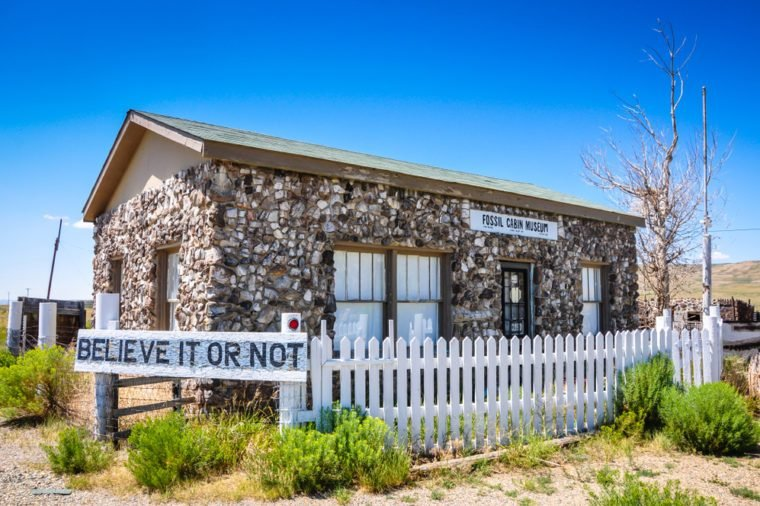 Medicine Bow, WY / USA - July 17, 2013: Beginning about 1915, Thomas Boylan used 5,796 dinosaur bones from nearby Como Bluff to build this cabin. The curiousity was used to house a museum.
