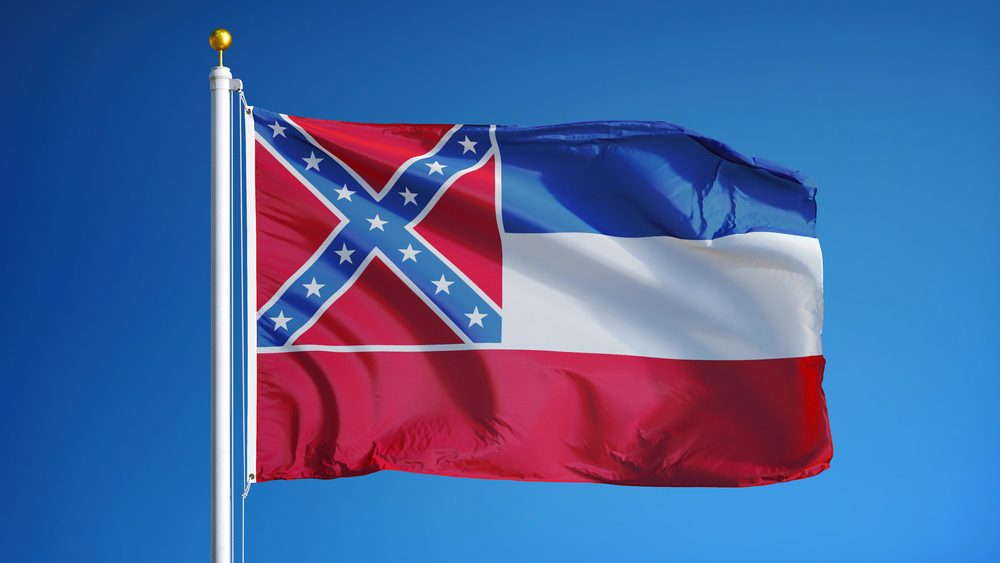 Mississippi (U.S. state) flag waving against clear blue sky, close up, isolated with clipping path mask alpha channel transparency, perfect for film, news, composition