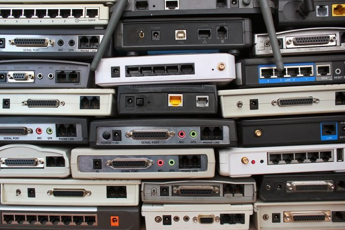 Old modems, routers, network equipment. Serial, phone, audio, ethernet connectors.
