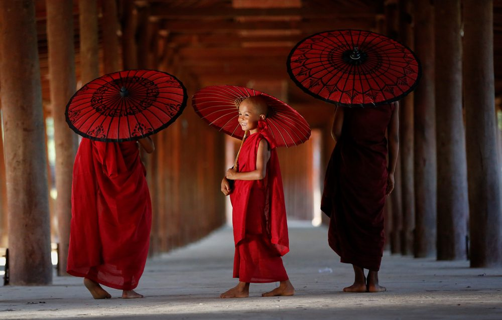 MONK MYANMAR, Southeast Asian young three little monk walkink morning alms in bagan, Buddhist in pagoda myanmar background,