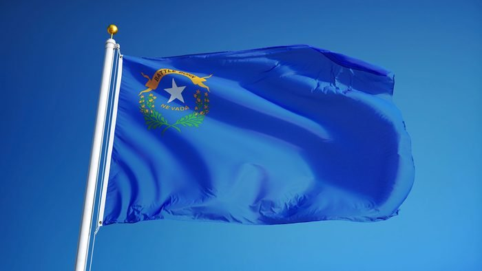 Nevada (U.S. state) flag waving against clear blue sky, close up, isolated with clipping path mask alpha channel transparency, perfect for film, news, composition