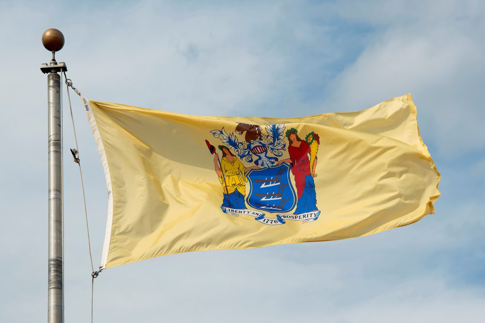 Flag of New Jersey in front of New Jersey State House, Trenton, New Jersey, USA.