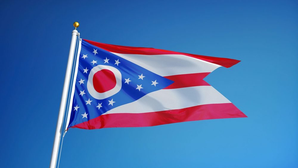 Ohio (U.S. state) flag waving against clear blue sky, close up, isolated with clipping path mask alpha channel transparency, perfect for film, news, composition