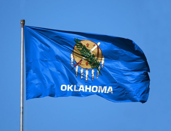 National flag State of Oklahoma on a flagpole