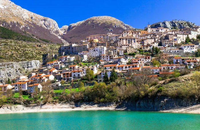 Pictorial emerald lake - Lago di Barrea and medieval village in Abruzzo, Italy