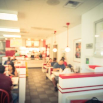 Blurred image a compact fast food restaurant in USA.