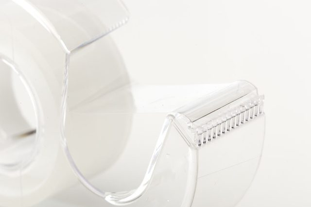 A Clear tape dispenser against a white background