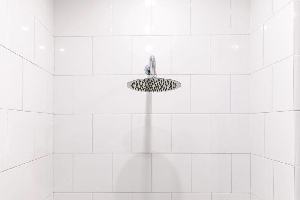 Chrome clean shower head in the bathroom