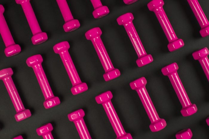 pink dumbbels isolated on black.
