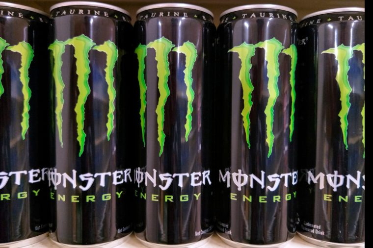 Kuala Lumpur, Malaysia- 26 February 2018:Monster energy drink cans on supermarket shelves.